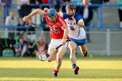Cork&#39;s Killian McIntyre and Jamie Barron of Waterford.<br />&#169;INPHO/James Crombie.