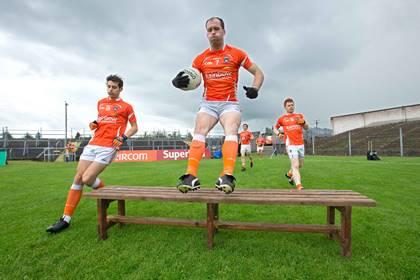 Armagh&#39;s Ciaran McKeever and Jamie Clarke arrive for the team photo against Roscommon at Dr Hyde Park.<br />&#169;INPHO/Morgan Treacy.