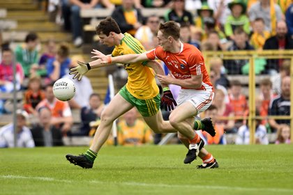 Donegal's Jamie Brennan up against Armagh's Cathal Donnelly during the Ulster MFC final at Clones ©INPHO/Presseye/Russell Pritchard