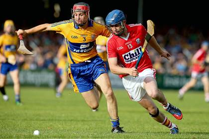 Cork&#39;s Anthony Spillane and Jack Browne of Clare during the Munster U21HC final.<br />&#169;INPHO.