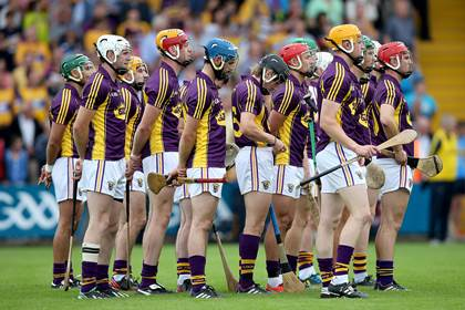 The Wexford team stand for the National Anthem<br />before the All-Ireland SHC Qualifiers Round 1 replay against Clare.<br />&#169;INPHO/Donall Farmer.
