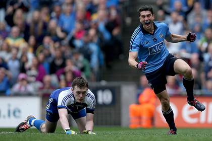 Bernard Brogan scores Dublin&#39;s second goal past goalkeeper Rory Beggan.<br />&#169;INPHO/Donall Farmer.