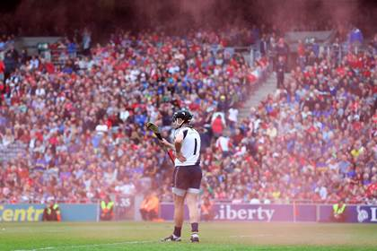 Tipperary goalkeeper Darren Gleeson surrounded by smoke from a flare ©INPHO/Cathal Noonan