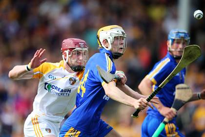 Antrim&#39;s Ryan McCambridge chases Aaron Cunningham of Clare during the All-Ireland U21HC semi-final.<br />&#169;INPHO/Cathal Noonan.