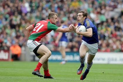 Kerry&#39;s David Moran gets by Jason Gibbons of Mayo during the All-Ireland SFC semi-final.<br />&#169;INPHO/Morgan Treacy.