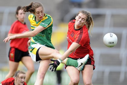 Leitrim's Aine Tighe scores a goal as Megan Doherty of Down attempt a block ©INPHO/Tommy Grealy