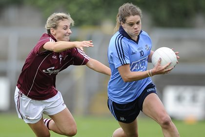 Dublin's Noelle Healy races awy from Sinead Burke of Galway ©INPHO/Tommy Grealy