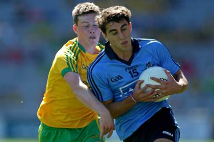 Dublin&#39;s Chris Sallier with Danny McGonagle of Donegal during the All-Ireland MFC semi-final.<br />&#169;INPHO/Donall Farmer.