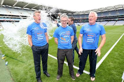 New Armagh manager Kieran McGeeney performing the &#39;Ice Bucket Challenge&#39; on RTE pundits Colm O&#39;Rourke, Joe Brolly and Pat Spillane.<br />&#169;INPHO/Cathal Noonan.