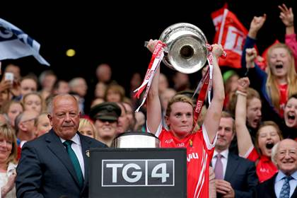 Cork&#39;s Briege Corkery lifts The Brendan Martin Cup.<br />&#169;INPHO/Ryan Byrne.