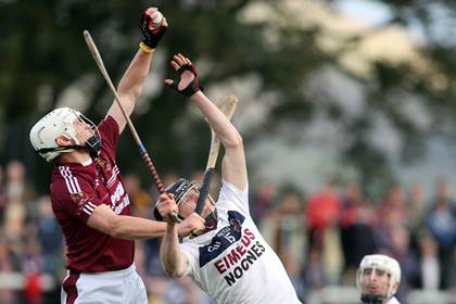 Cushendall&#39;s Arron Graffin makes a fine catch over Brendan Rogers of Slaughtneil.<br />&#169;INPHO/Presseye/Lorcan Doherty.