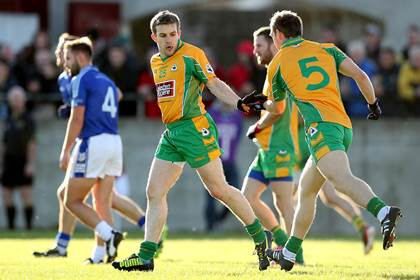 A job well done. Corofin&#39;s Joe Canney celebrates a point with Ciaran McGrath.<br />&#169;INPHO/James Crombie.