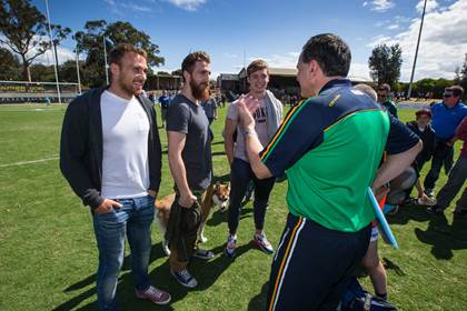 Ireland manager Paul Earley speaks with former Ireland and current AFL players Ciaran Sheehan, Zach Tuohy and Ciaran Byrne after the warm-up game versus the VFL Selection.<br />&#169;INPHO/Cathal Noonan.