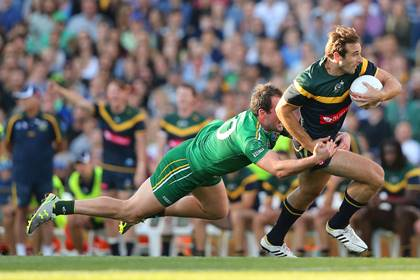 Ireland&#39;s Michael Murphy tackles Jobe Watson of Australia during the opening quarter at Patersons Stadium.<br />&#169;INPHO.