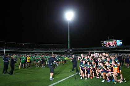 Australia players celebrate with the Cormac McAnallen Cup as the Ireland team look on.<br />&#169;INPHO/Cathal Noonan.