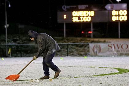 The pitch is cleared of snow ahead of the Queens v IT Sligo in the Sigerson Cup game ©INPHO/Presseye/Matt Mackey