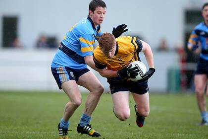 UCD&#39;s Ryan Wylie with Conor McHugh of DCU.<br />&#169;INPHO/Donall Farmer.