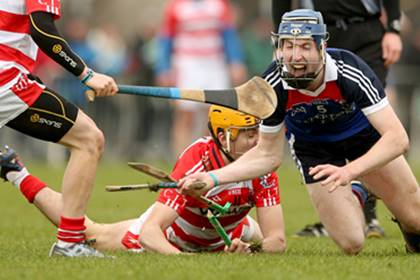 CIT&#39;s John Cronin breaks his hurl tackling Stephen Roche of WIT during the Fitzgibbon Cup semi-final.<br />&#169;INPHO/James Crombie.