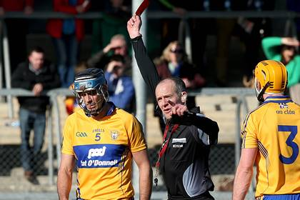 Brendan Bugler is sent off by referee Cathal McAllister.<br />&#169;INPHO/Donall Farmer.
