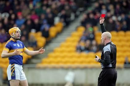 Referee John Keenan shows a red a card to Seamus Callanan of Tipperary.<br />&#169;INPHO/Morgan Treacy.