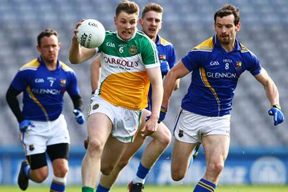 Offaly&#39;s Johnny Moloney makes a break past Barry Gilleran of Longford during the FL Division 4 final.<br />&#169;INPHO/Cathal Noonan.