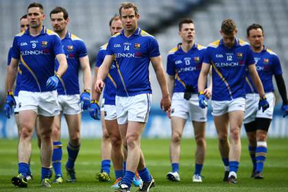 Brian Kavanagh and his Longford team mates.<br />&#169;INPHO/Cathal Noonan.
