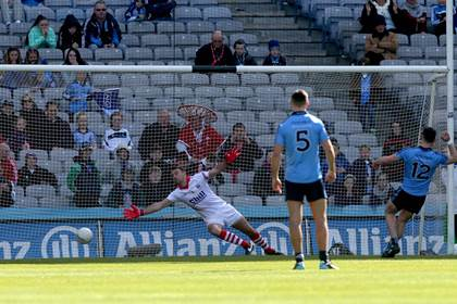 Dublin&#39;s Diarmuid Connolly scores a penalty past Cork goalkeeper Ken O&#39;Halloran.<br />&#169;INPHO/Donall Farmer.