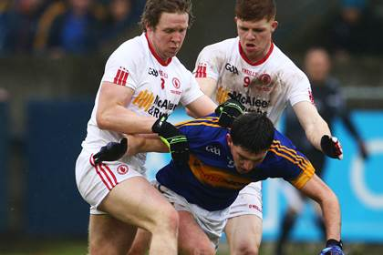 Tipperary&#39;s Colin O&#39;Riordan is tackled by Frank Burns and Cathal McShane of Tyrone.<br />&#169;INPHO/Cathal Noonan.
