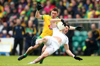 Donegal&#39;s Martin O&#39;Reilly tackles Mattie Donnelly of Tyrone during the Ulster SFC preliminary round tie at Ballybofey.<br />INPHO.