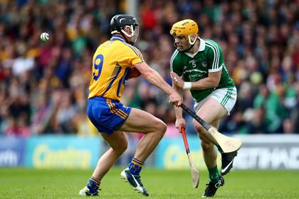 Limerick&#39;s Seanie O&#39;Brien and Shane Golden of Clare during the Munster SHC quarter-final at Semple Stadium.<br />&#169;INPHO/Cathal Noonan.