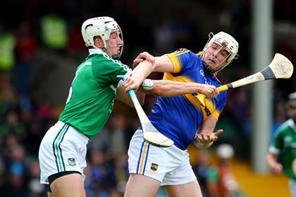 Limerick&#39;s Barry O&#39;Connell and David Butler of Tipperary battle for possession in the Munster IHC semi-final at the Gaelic Grounds.<br />&#169;INPHO/Cathal Noonan.