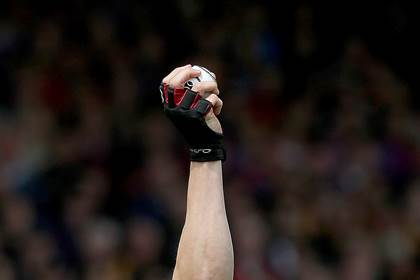 A view of a hurling glove and sliotar.<br />&#169;INPHO/Donall Farmer.