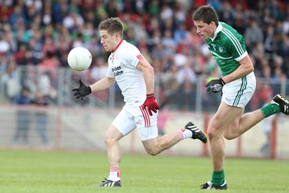 Tyrone&#39;s Mark Bradley and Gearoid Hegarty of Limerick.<br />&#169;INPHO/Presseye/Andrew Paton.