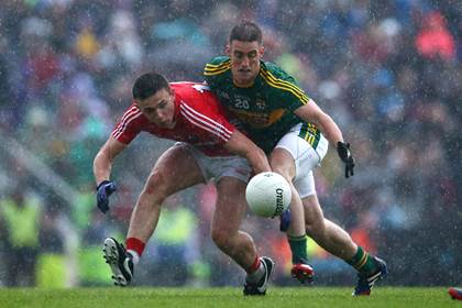 Kerry&#39;s Stephen O&#39;Brien and Mark Collins of Cork during the Munster SFC final replay at Fitzgerald Stadium, Killarney.<br />&#169;INPHO/Cathal Noonan.