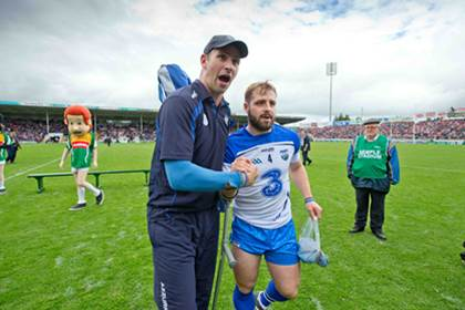 Waterford selector Dan Shanahan celebrates with Noel Connors after the All-Ireland SHC quarter-final.<br />&#169;INPHO/Morgan Treacy.