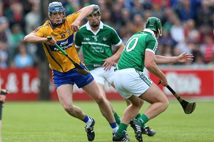 Clare&#39;s Bobby Duggan and Ronan Lynch of Limerick during the Munster U21HC final at Cusack Park, Ennis.<br />&#169;INPHO/Ryan Byrne.
