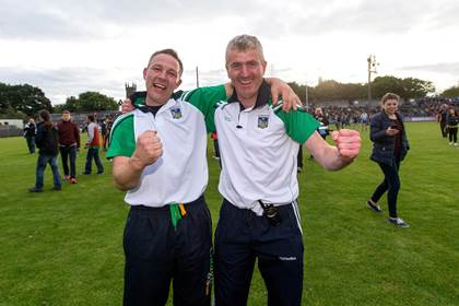 Limerick coach Ross Corbett and manager John Kiely celebrate after the Munster U21HC final victory over Clare at Cusack Park, Ennis.<br />&#169;INPHO/Ryan Byrne.
