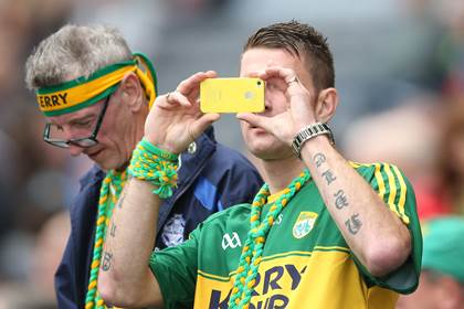 A Kerry fan captures the day at the All-Ireland SFC quarter-finals.<br />&#169;INPHO/James Crombie.
