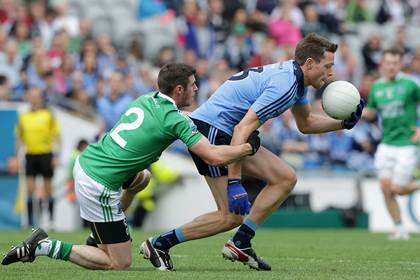 Dublin&#39;s Dean Rock with Mickey Jones of Fermanagh during the All-Ireland SFC quarter-final.<br />&#169;INPHO/Morgan Treacy.