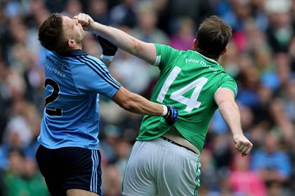 Dublin&#39;s Jonny Cooper with Sean Quigley of Fermanagh.<br />&#169;INPHO/Donall Farmer.