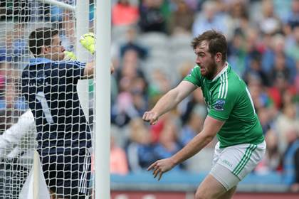 Fermanagh&#39;s Sean Quigley scores a goal by pushing Dublin goalkeeper Stephen Cluxton into the net with the ball during the All-Ireland SFC quarter-final.<br />&#169;INPHO/Morgan Treacy.