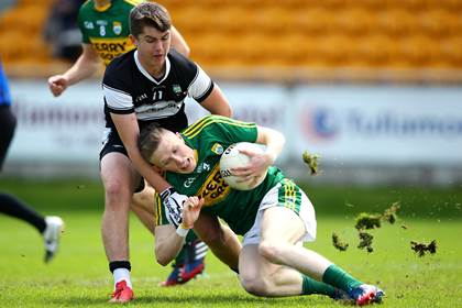 Kerry&#39;s Jason Foley is tackled by Patrick O&#39;Connor of Sligo during the All-Ireland MFC quarter-final at O&#39;Connor Park, Tullamore.<br />&#169;INPHO/Cathal Noonan.