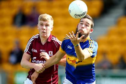 Galway&#39;s Ian Kent and Aidan Buckley of Tipperary during the All-Ireland MFC quarter-final at O&#39;Connor Park, Tullamore.<br />&#169;INPHO/Cathal Noonan.