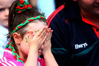 A Mayo supporter can barely watch on during the drawn All-Ireland SFC semi-final against Dublin.<br />&#169;INPHO/Donall Farmer.