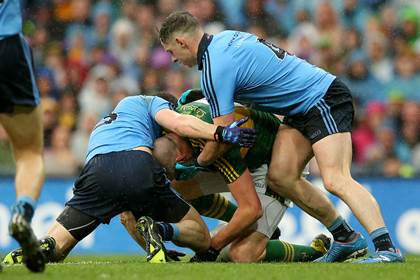 Dublin&#39;s Rory O&#39;Carroll and Philly McMahon tackle Kieran Donaghy of Kerry during the All-Ireland SFC final.<br />&#169;INPHO/James Crombie.