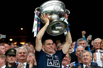 Dublin captain Stephen Cluxton lifts the Sam Maguire Cup.<br />&#169;INPHO/James Crombie.