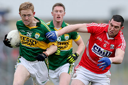 Kerry's Colm Cooper and Noel O'Leary of Cork. INPHO