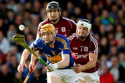 Tipperary&#39;s Lar Corbett with Joseph Cooney and Andy Smith of Galway<br />&#169;INPHO