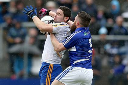Wicklow&#39;s Seanie Furlong is tackled by Paul Begley of Laois.<br />&#169;INPHO/Donall Farmer.