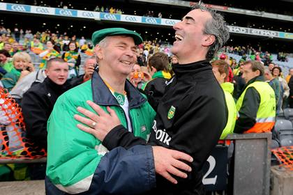 Donegal's two All-Ireland winning managers celebrate after the final whistle - Brian McEniff and Jim McGuinness ©INPHO/James Crombie